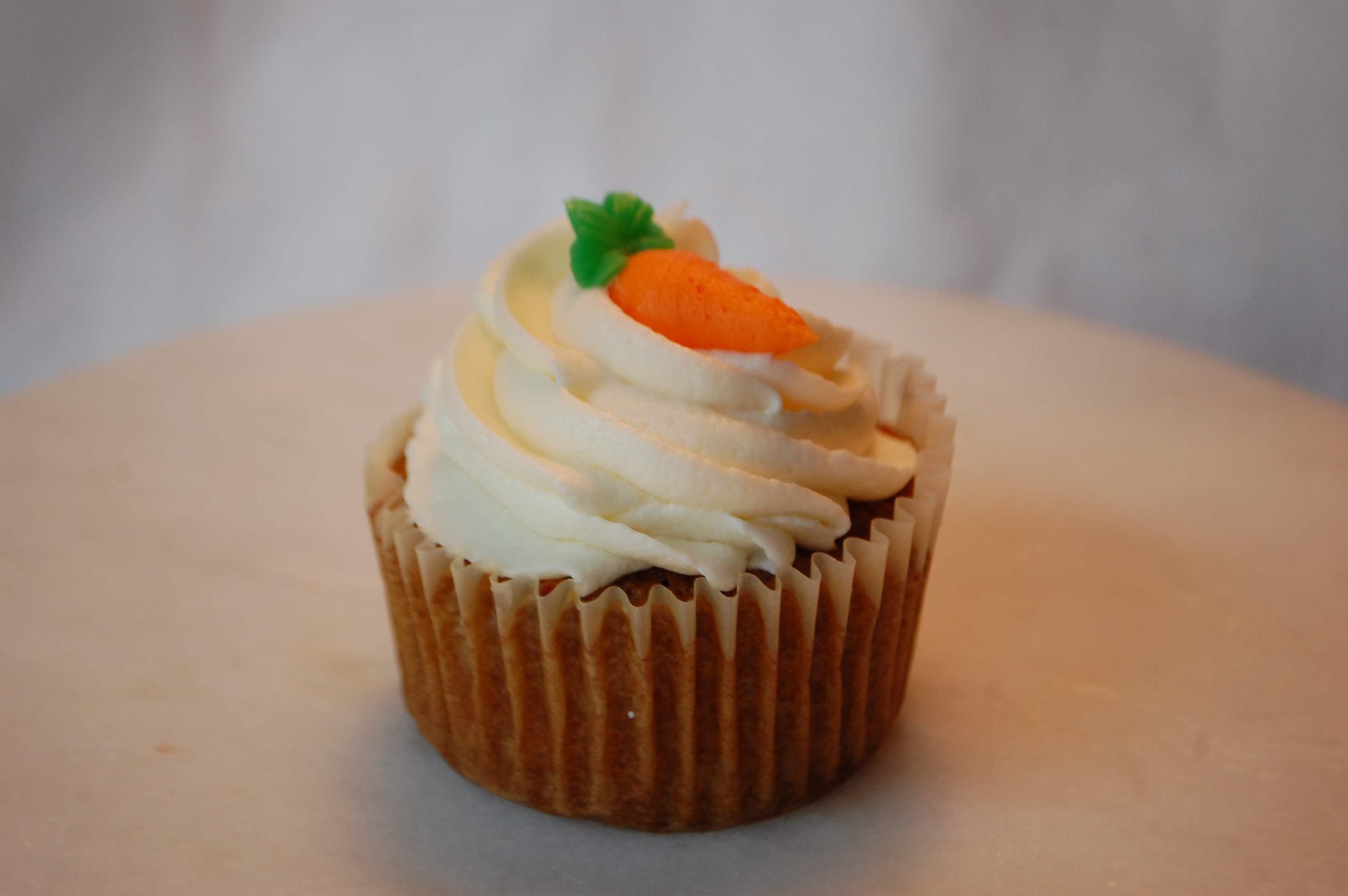 A moist cake chocked full of carrots, walnuts and pineapple. Covered in a cream cheese icing.